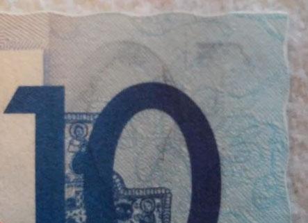 Волнистый край банкноты